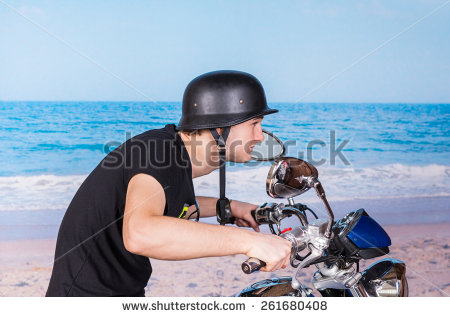 stock-photo-young-man-in-a-retro-helmet-speeding-on-his-motorbike-as-he-crouches-low-over-the-handlebars-while-261680408