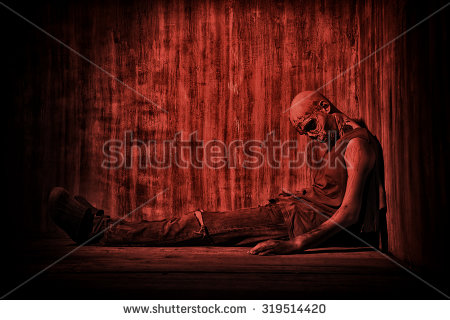 stock-photo-frightening-bloody-zombie-man-in-blood-red-light-halloween-319514420