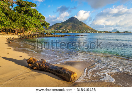 stock-photo-rocky-and-sandy-shore-in-tamarin-bay-wolmar-flic-en-flac-mauritius-island-indian-ocean-318419426