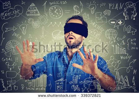 stock-photo-blindfolded-young-business-man-searching-walking-through-complicated-social-media-financial-data-339372821